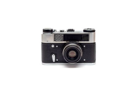Soviet old camera with leather elements on the body with the lens. Isolate