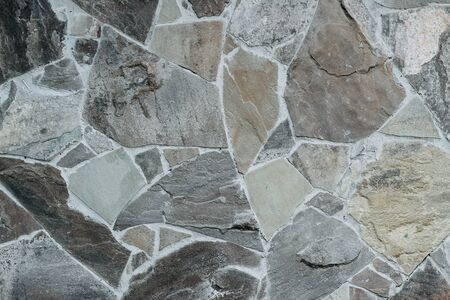 wall of natural large granite stones bonded to each other with cement