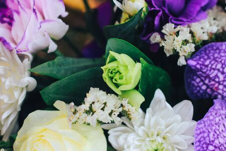 A bouquet of flowers in purple tones with a bud of eustoma and chrysanthemum. Close view