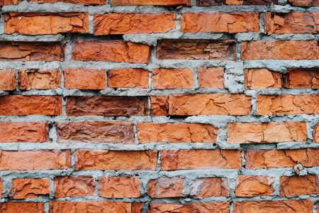 wall of the house of the old red brick. texture and background for designers