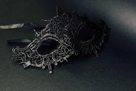 female carnival lace mask on a black background Reklamní fotografie