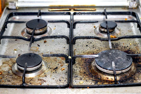 Dirty gas stove. Grease contamination on the stove. Imagens