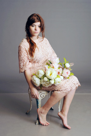 floret: summer dress, dress in a floret, girl with flowers, bouquet, beautiful bouquet in hands at the girl Stock Photo