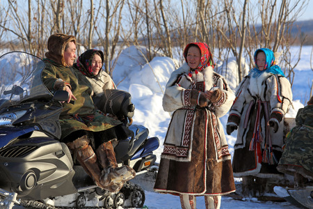 Nadym, Russia - March 02, 2014: Family of Nenets on a traditional holiday Day of the reindeer breeder. Nenets - the indigenous small people of the Russian North Editorial