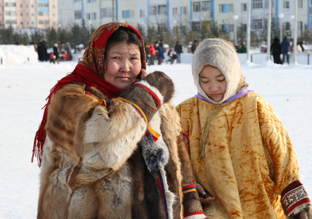 Nadym, Russia - March 07, 2010: Family of Nenets on a traditional holiday Day of the reindeer breeder. Nenets - the indigenous small people of the Russian North