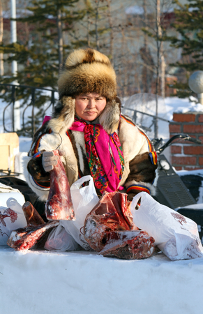 eskimo woman: Nadym, Russia - on March 05, 2011: The woman the Nenets woman in national clothes on a traditional holiday Day of the reindeer breeder. The Nenets - aboriginals of the Russian North Editorial