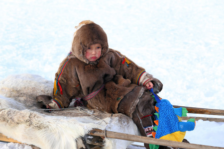breeder: NADYM, RUSSIA - MARCH 14, 2015: The boy the Nenets on a traditional holiday Day of the reindeer breeder. Nenets - the indigenous small people of the Russian North