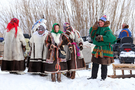 NADYM, RUSSIA - MARCH 14, 2015: Group of Nenets in national clothes during the holiday Day of the reindeer breeder. Nenets - aboriginals of the Russian North