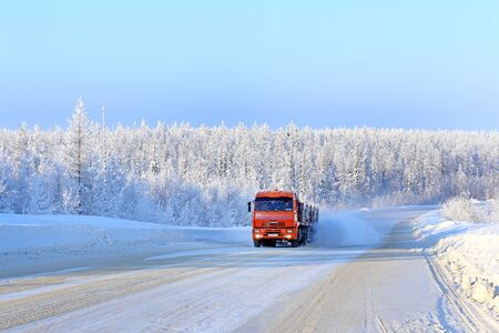Yamal Peninsula, Russia, February 15, 2014. Cars go on the way to a gas field