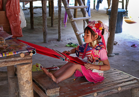 thailand: Thailand - DECEMBER 26, 2013: the girl of a tribe of long necks behind work Editorial