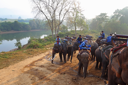 mahout: Thailand - DECEMBER 30, 2013: Drivers of elephants early in the morning on the river bank