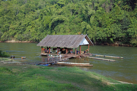 house float on water: Thailand - DECEMBER 29, 2013: Boats and rafts with tourists on the river Kwai