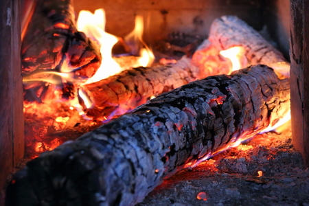 burns: Firewood burns in the home furnace Stock Photo