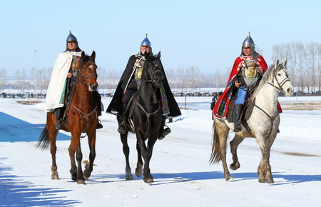 farewell: Riders in suits of ancient Russian soldiers during the holiday Farewell to winter Editorial