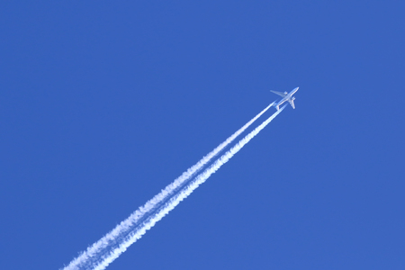 The passenger plane highly in the sky
