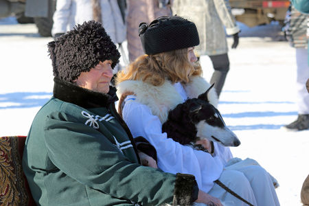 belokurikha: BELOKURIKHA, RUSSIA - MARCH 12, 2016: Maslenitsa is a Russian religious and folk holiday. The man and the woman in ancient noble suits go by sledge