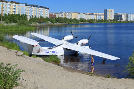 hydroplane: NADYM, RUSSIA - JUNE 22, 2016: The Russian  L-42m RA-1948G hydroplane on the bank of a city pond Editorial