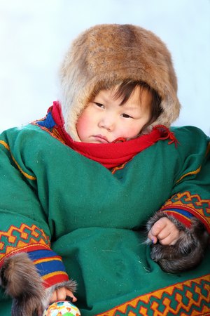 herder: NADYM, RUSSIA - MARCH 14, 2015: Nenets child in traditional holiday Day of the reindeer herder. Nenets - aboriginals of the Russian North