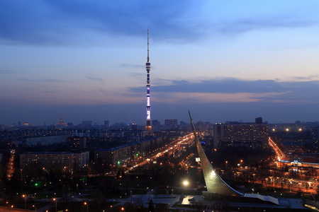 Moscow, RUSSIA - APRIL 29, 2017: The view at night to the Ostankino tower and the monument to the conquerors of space