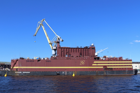 Saint Petersburg, RUSSIA - MAY 03, 2017: The worlds first floating nuclear power block Akademik Lomonosov at the quay wall of the Baltic shipyard