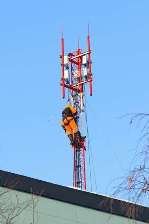 Installers install the equipment on the mast of cellular communication