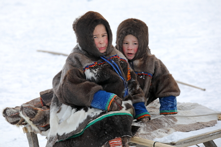 NADYM, RUSSIA — MARCH 04, 2018: Two boys Nenets during the traditional holiday of the reindeer breeder Day. Nenets — aboriginals of the Russian North Sajtókép
