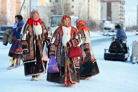 NADYM, RUSSIA - MARCH 04, 2018: Nenets women in bright traditional fur garments malitsa Editorial