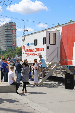 Novosibirsk, RUSSIA-JULY 04, 2018: Volunteers donate blood at a mobile blood transfusion point Editorial