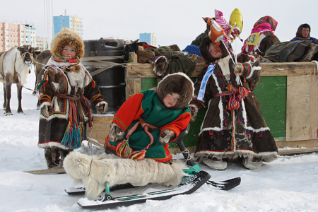 NADYM, RUSSIA-MARCH 16, 2008: small Nenets children at the festival. Nenets - aboriginals of the Russian North
