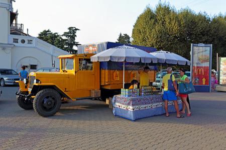 Sochi, RUSSIA-AUGUST 13, 2013: sale of Krasnodar tea brand Baloven and old Soviet truck ZIS