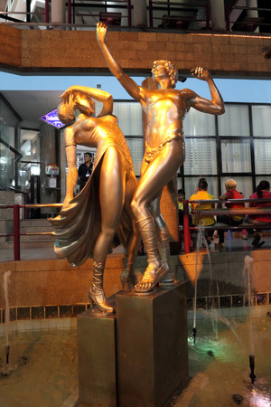 PATTAYA, THAILAND-MARCH 27, 2012: Sculptural composition in front of the Alcazar transvestite show
