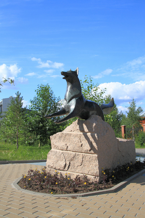SURGUT, RUSSIA-JULY 07, 2011: black Fox Sculpture on a summer day in the city square