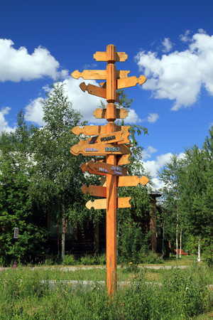 SURGUT, RUSSIA-JULY 07, 2011: Wooden pole showing distances to major Russian cities