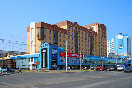 SURGUT, RUSSIA-JULY 27, 2013: Mir shopping center Building on a Sunny summer day