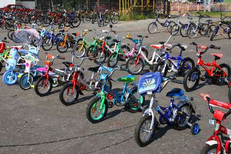 SURGUT, RUSSIA-AUGUST 25, 2009: sale of childrens bicycles in the city market on a summer day