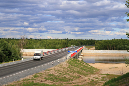 NADYM, RUSSIA-JULY 06, 2011: Bridge over the Right Hetta river in Yamalo-Nenets district of Russia. Federal highway Surgut-Salekhard