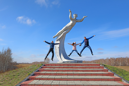 BAYEVO, RUSSIA-OCTOBER 22, 2019: Tourists jump near the monument to the first woman cosmonaut Valentina Tereshkova at the site of her landing in the Bayevsky district of Altai Krai Editorial
