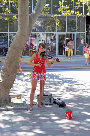 GELENDZHIK, RUSSIA-AUGUST 08, 2015: a Girl plays an electric violin on the resort embankment on The black sea coast