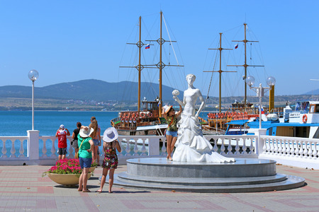 GELENDZHIK, RUSSIA-AUGUST 08, 2015: Tourists are photographed near the sculpture with the name White bride on the black sea coast