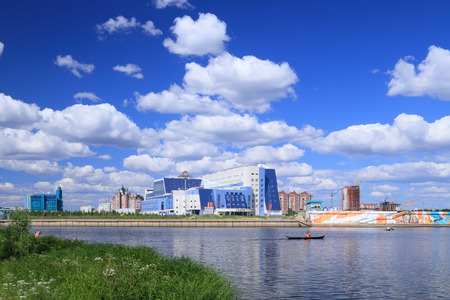 SURGUT, RUSSIA-JULY 07, 2011: View from the Bank of the Saimaa river to the theater of Surgut state University