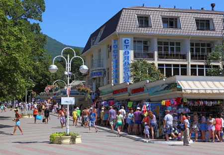 GELENDZHIK, RUSSIA-AUGUST 08, 2015: Tourists near the mini market and the hotel building on The black sea coast