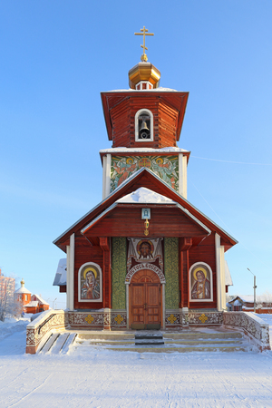 Novy Urengoi, RUSSIA-FEBRUARY 10, 2016: Wooden Orthodox Church of St. Seraphim of Sarov on a frosty winter morning in the North of Western Siberia