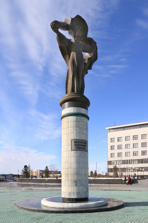Novy Urengoi, RUSSIA-APRIL 14, 2012: Monument to the Pioneers of Urengoi development on the square in front of the office of Gazprom dobycha Urengoi
