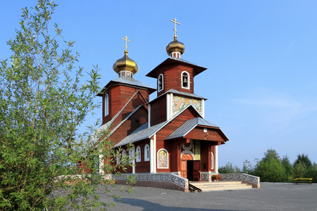 Novy Urengoi, RUSSIA-JULY 20, 2012: Wooden Orthodox Church of St. Seraphim of Sarov on a summer day in the North of Western Siberia