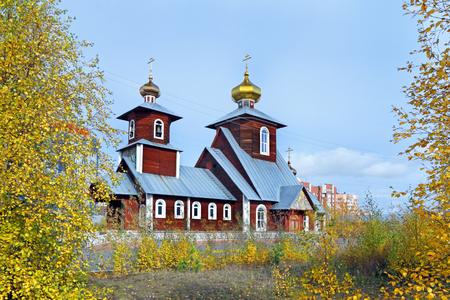 Novy Urengoi, RUSSIA-SEPTEMBER 08, 2012: Wooden Orthodox Church of St. Seraphim of Sarov on an autumn day in the North of Western Siberia