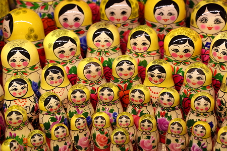 Colorful Russian folk toy matryoshka On the shop window for tourists Editorial