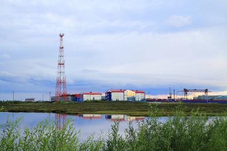 Novy Urengoi, RUSSIA-JULY 06, 2011: Evening landscape with industrial enterprises in Yamalo-Nenets Autonomous Okrug