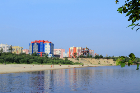 Novy Urengoi, RUSSIA-JULY 20, 2012: Urban landscape with vacationers on the sandy Bank of the Sede-Yakha river in Yamalo-Nenets Autonomous Okrug