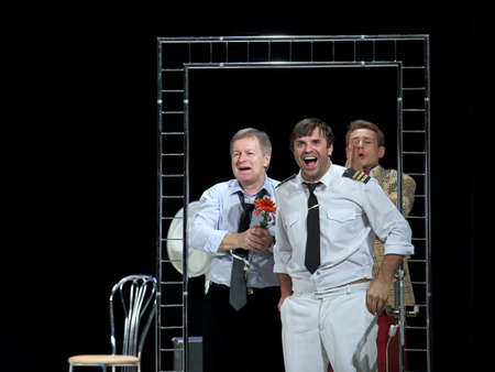 Nadym, RUSSIA-NOVEMBER 30, 2014: theater and film Actors Igor Livanov, Sergey Astakhov, Dmitry Isaev on stage in a play called SOS