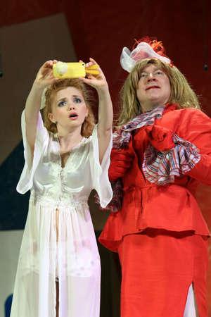 Nadym, RUSSIA-APRIL 18, 2015: Actors Olga Kuzmina and Alexander Korzhenkov on stage in a play called Posh wedding